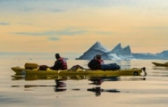 Sea kayaking with icebergs in Greenland
